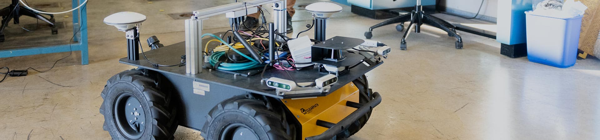 Robotic with four wheels and sensors in a lab